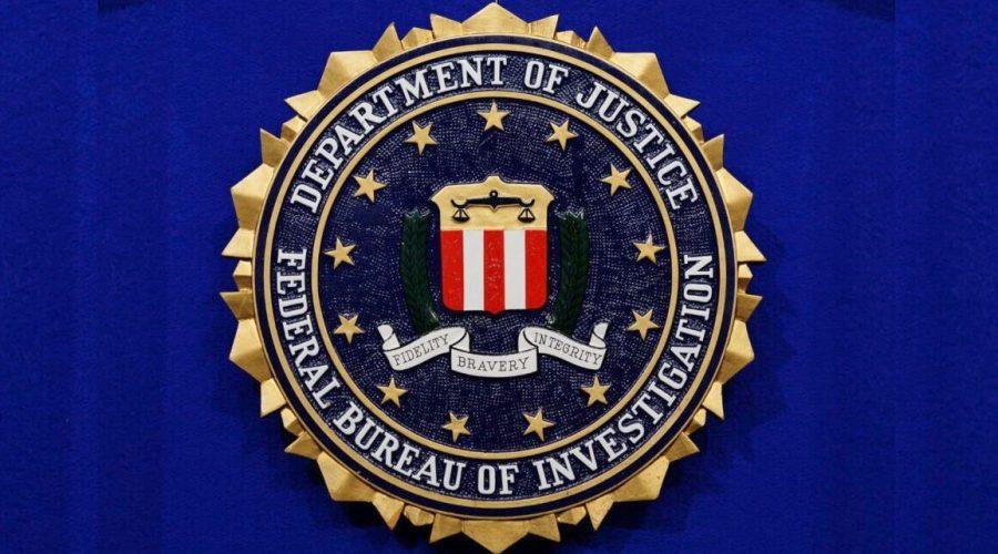 Znak Federálního úřadu pro vyšetřování - FBI. (Mandel Ngan/AFP via Getty Images)