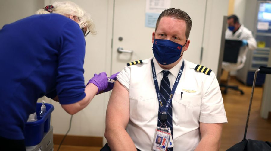United Airlines Employees Receive COVID 19 Vaccination At O'Hare Airport